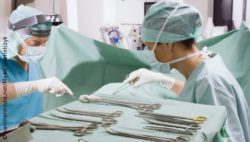 Photo: A man and a woman in the OR