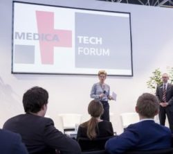 Image: A man and a women at the stage of MEDICA TECH FORUM