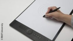 Photo: Test person drawing a spiral on a digital drawing tablet; Copyright: RMIT University