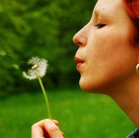 Picture: A woman and a dandelion