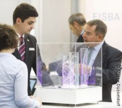 Image: Two men are talking at COMPAMED trade fair; © Messe Düsseldorf