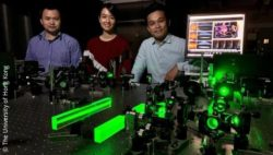 Picture: three people standing behind a 3D fluorescence microscope; Copyright: The University of Hong Kong