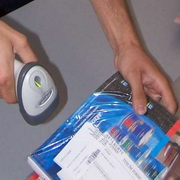 Photo: A hand scanning the barcode of a product