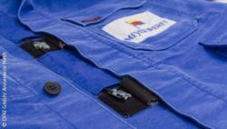Photo: Part of a boiler suit with logo from the company MEYER WERFT