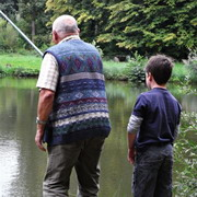 photo: grandfather and grandson fishing