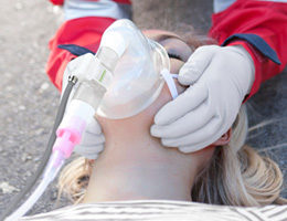 Image: Woman being ventilated with an oxygen mask