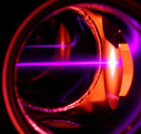 Photo: A purple laser beam
