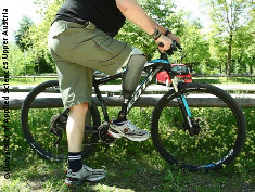 Photo: Man with prothesis and a bike