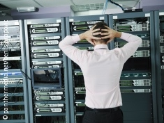 Photo: desperate man in front of a data server