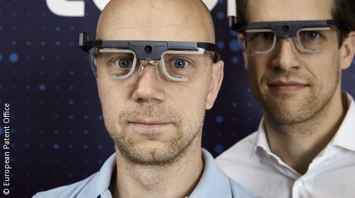 Photo: Two men wearing sensor glasses