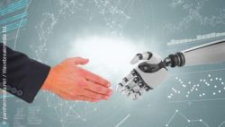 Image: Hands of a robot and a human being; Copyright: panthermedia.net / Wavebreakmedia Itd.