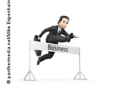 Graphic: Business man jumping over an obstacle