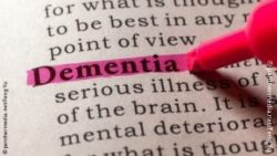 "Image: book page where the word ""dementia"" is highlighted in pink; Copyright: panthermedia.net/Feng Yu"