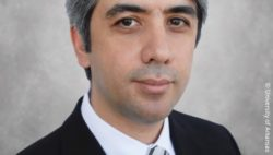 Image: Dark-haired man in black suit - Sayed Omid Sayedaghaee; Copyright: University of Arkansas