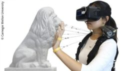 Image: Woman with multi string devices touches a lion head sculputre; Copyright: Carnegie Mellon University
