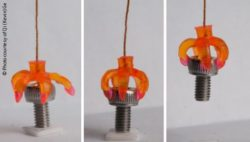Image: a 3-D printed multimaterial shape-memory minigripper; Copyright: Photo courtesy of Qi (Kevin) Ge