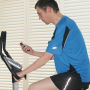 Photo: Man training on a cycle ergometer