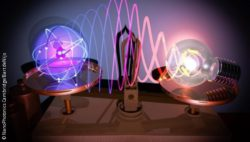 Image: Graphic of a huge atom on a scale and a bulb; Copyright: NanoPhotonics Cambridge/Bart deNijs