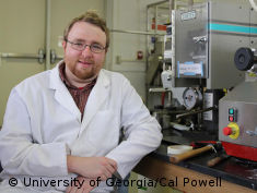 Photo: Smiling scientist with glasses and beard - Alex Jones