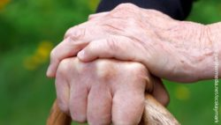 Image: an elderly person's hands clinging to a walking stick; Copyright: panthermedia.net/ocskaymark