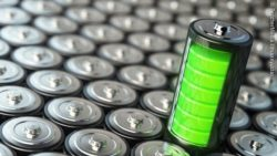 Image: a battery with green inlay standing on a couple of other batteries ; Copyright: PantherMedia / maxxyustas